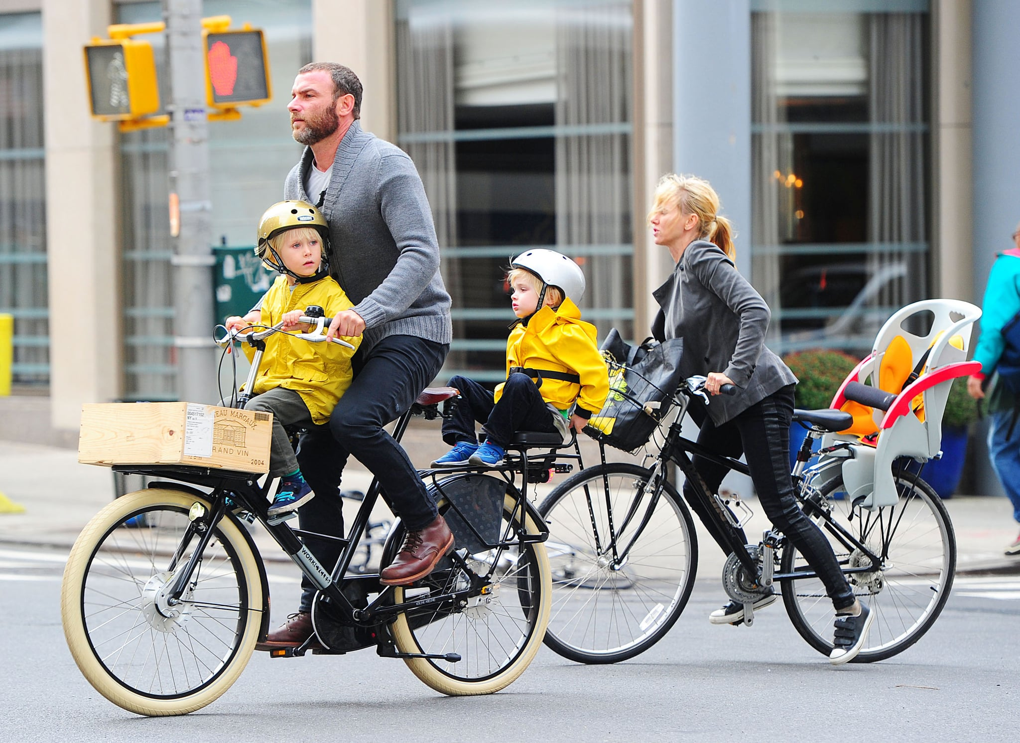 Liev Schreiber and Naomi Watts strapped their boys on their bikes for a ride around NYC.
