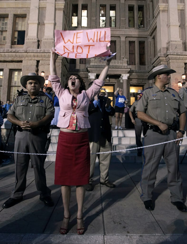 "One pro-choice woman held up a sign that read, ""We will not yield."""