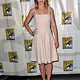 Emily Blunt offset a nude tea-length dress with bright orange sandals.