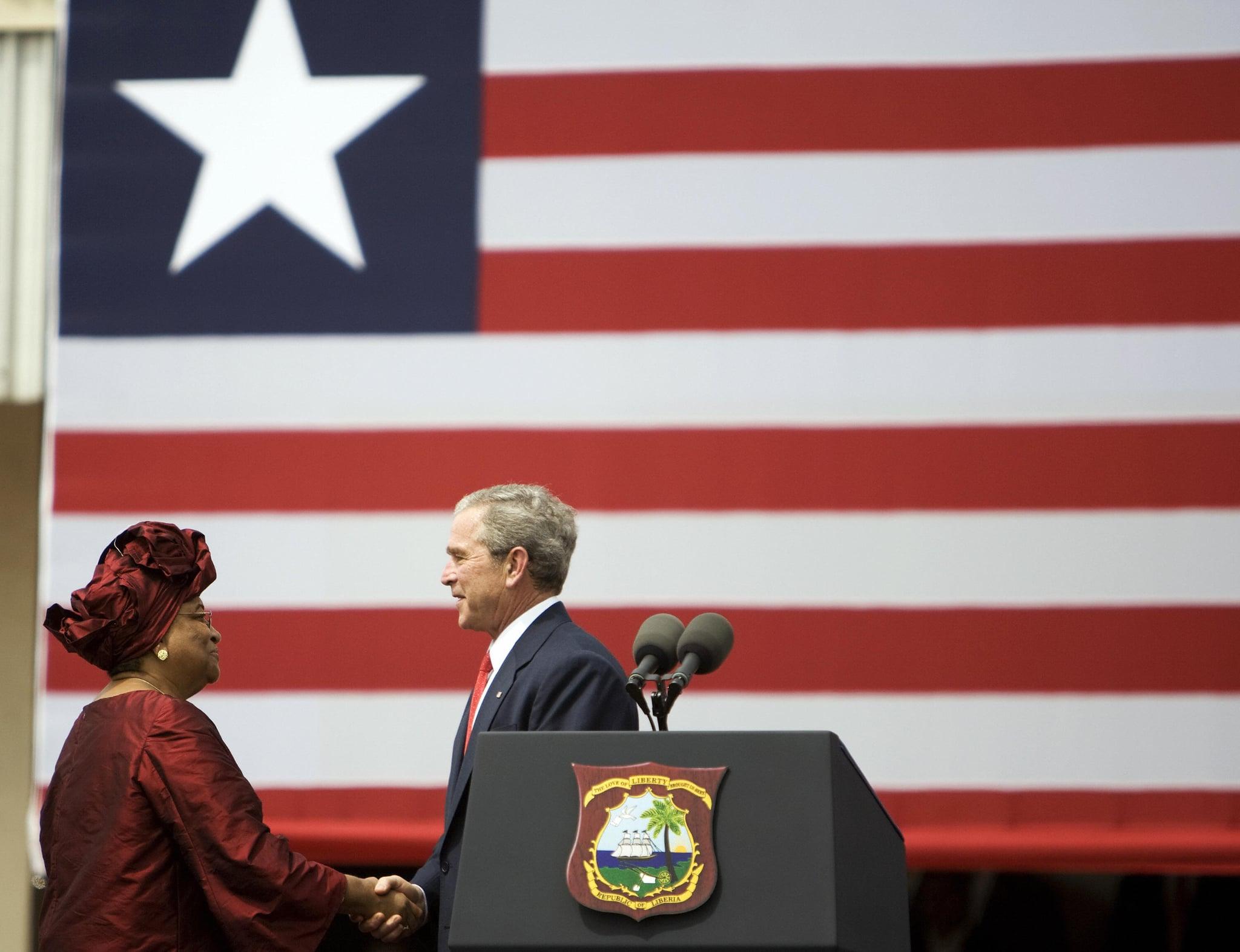 Liberia's President Ellen Johnson-Sirleaf greets Bush on February 21, 2008.