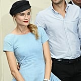 Diane Kruger struck a pose with Joshua Jackson by her side at the Chanel show in Paris.