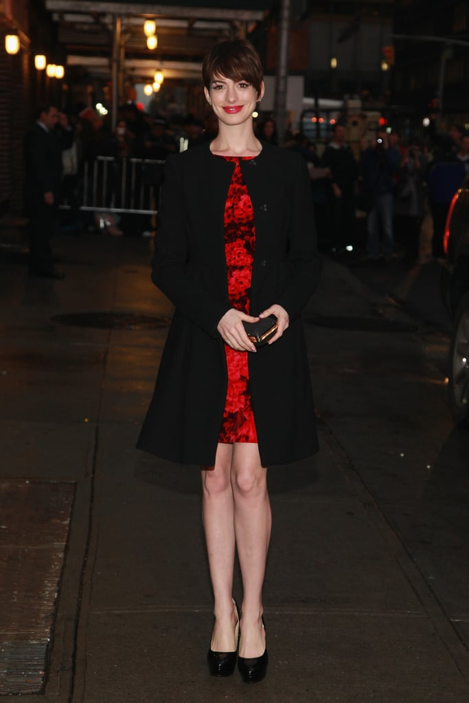 Anne accessorized her look with perfectly ladylike accoutrements, like a box clutch in hand and a classic wool coat.