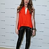 In March, Christa paired an eye-catching red blouse with edgy black leather pants.