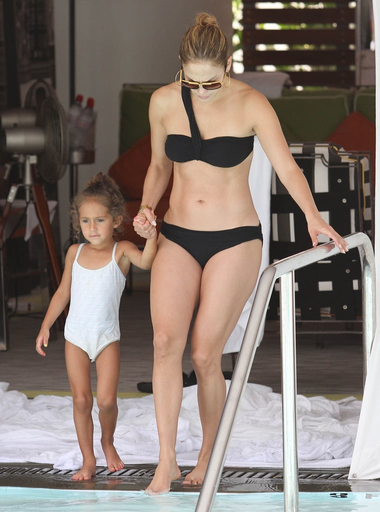 Jennifer Lopez wore a black bikini to hit the pool in Miami with daughter Emme.