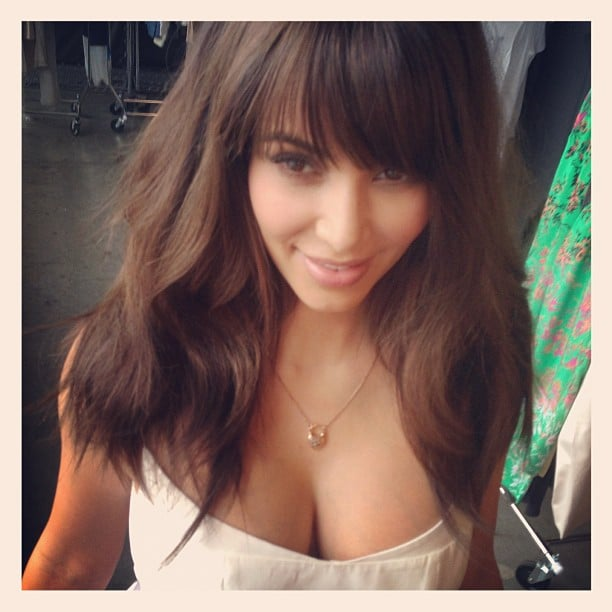 Kim Kardashian revealed her (fake) new fringe and lighter, shorter 'do. Source: Instagram user mrchrismcmillan