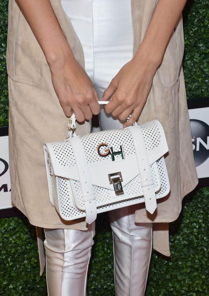 Gigi showed off her monogrammed bag on the carpet.