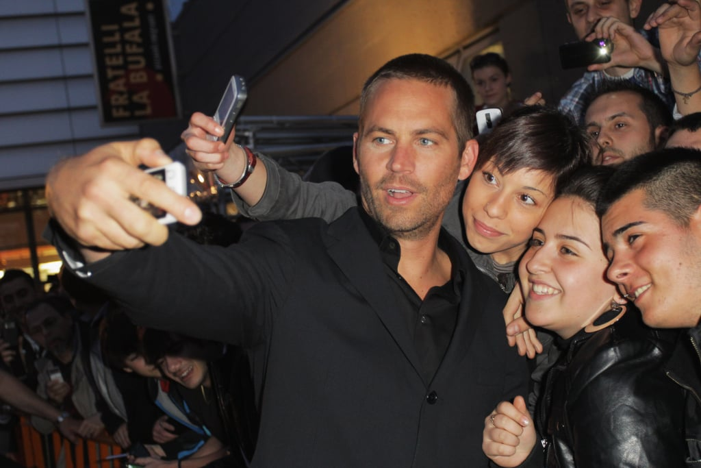 Paul Walker snapped photos with a group of fans during the Fast & Furious 5 premiere in Rome, Italy, in April 2011.