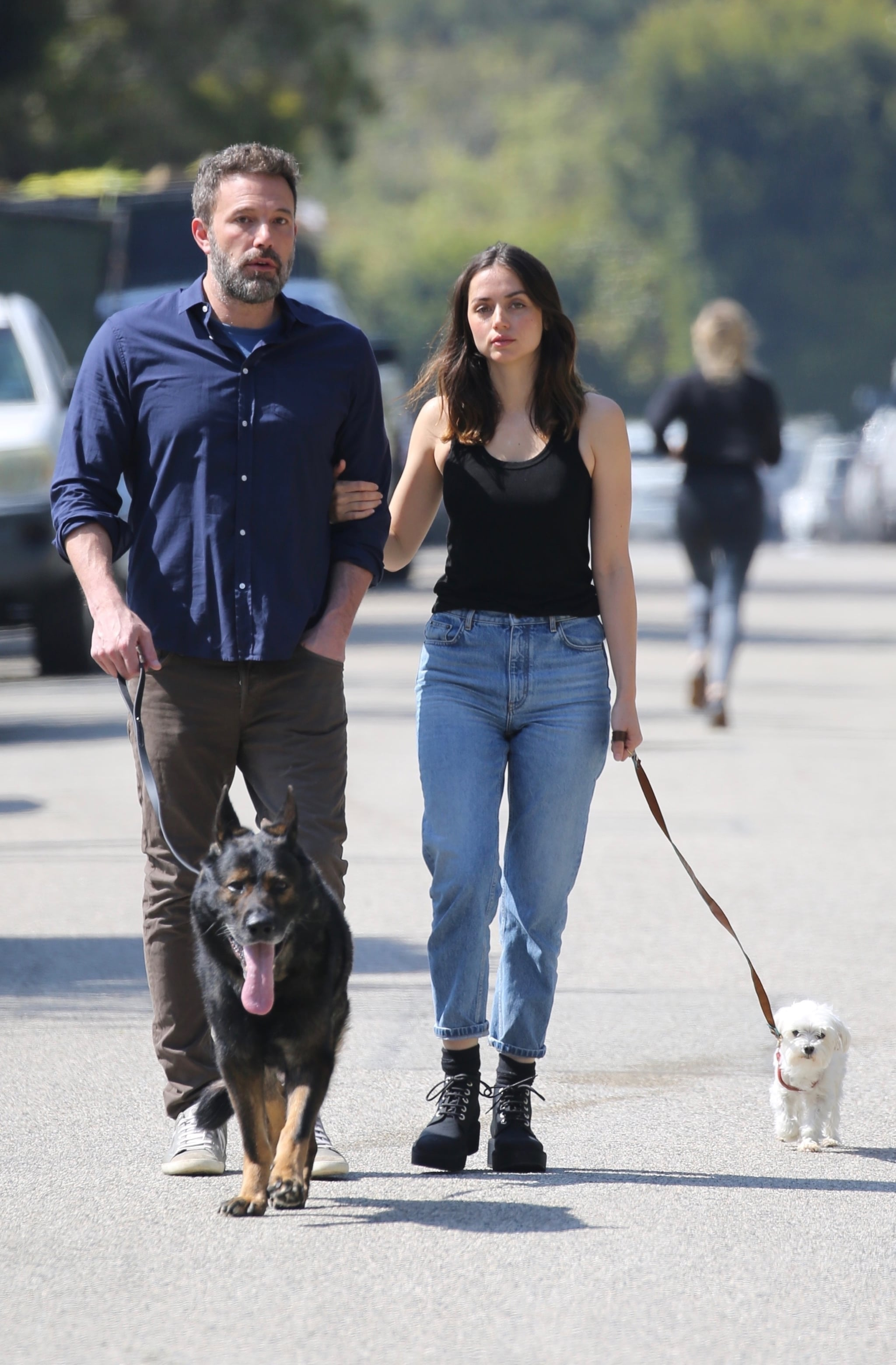 Brentwood, CA  - Ben Affleck takes a walk with girlfriend Ana de Armas this morning with their dogs. Ben stopped to take a photos of photographers on the street bringing a smile to Ana's face.Pictured: Ben Affleck, Ana de ArmasBACKGRID USA 1 APRIL 2020 BYLINE MUST READ: Paparazzi Podcast / BACKGRIDUSA: +1 310 798 9111 / usasales@backgrid.comUK: +44 208 344 2007 / uksales@backgrid.com*UK Clients - Pictures Containing ChildrenPlease Pixelate Face Prior To Publication*