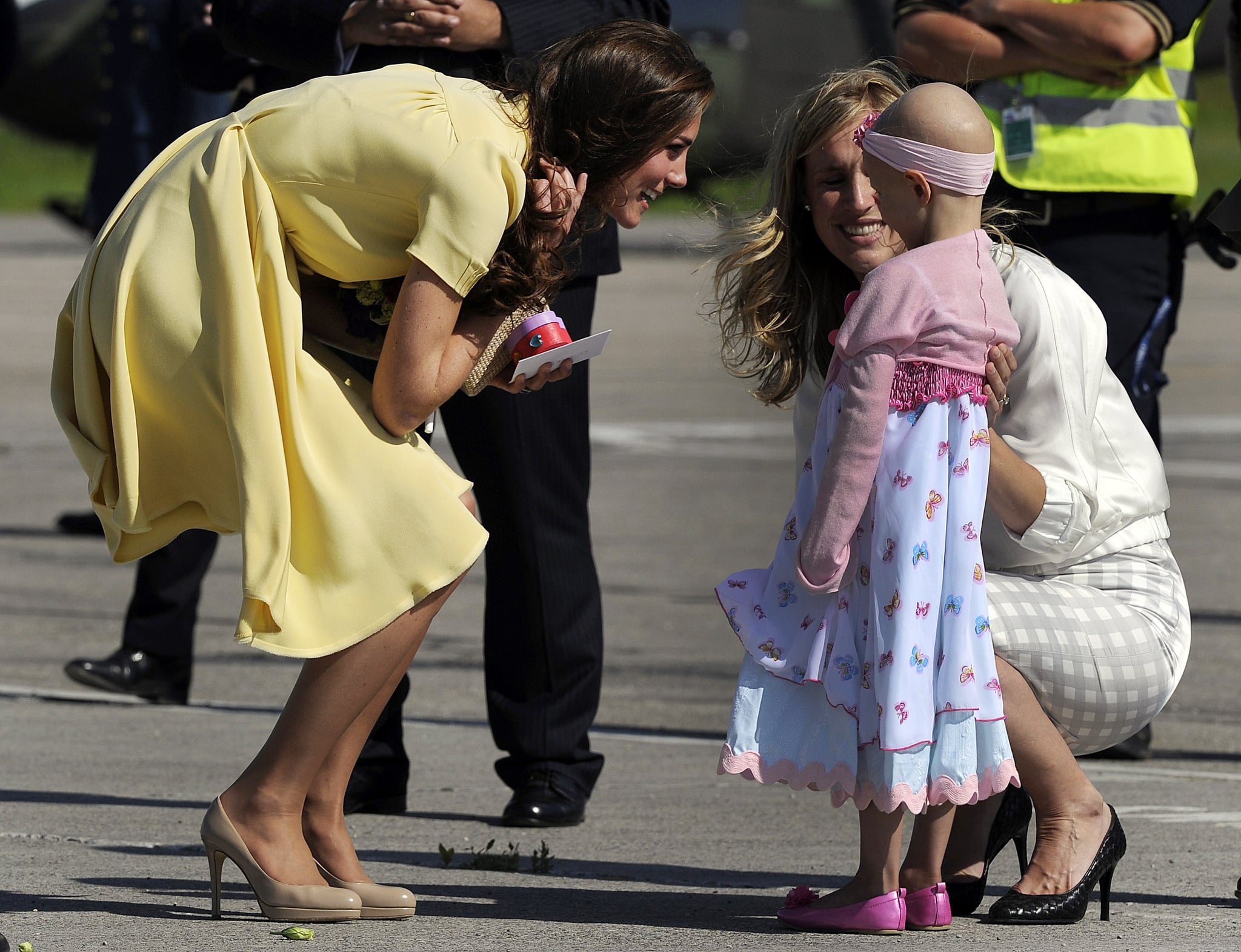 Kate Middleton and Prince William were met by fans on the tarmac in Calgary.