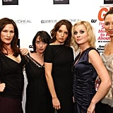 Tina and Amy joked around while posing with fellow SNL stars at Glamour's Women of the Year Awards in 2002.