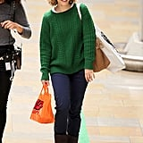 Rachel McAdams walked through Paddington Station with a friend.