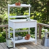 This white-washed potting bench ($170) is full of traditional charm and lots of storage.