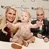 There was three times the blondness when Jessica and Ashlee Simpson posed with Maxwell in North Carolina.