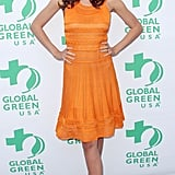 Miranda Kerr was Summer-ready in a ruffled Christian Dior knit and nude Christian Louboutins in Santa Monica, CA, at a 2011 Global Green event.
