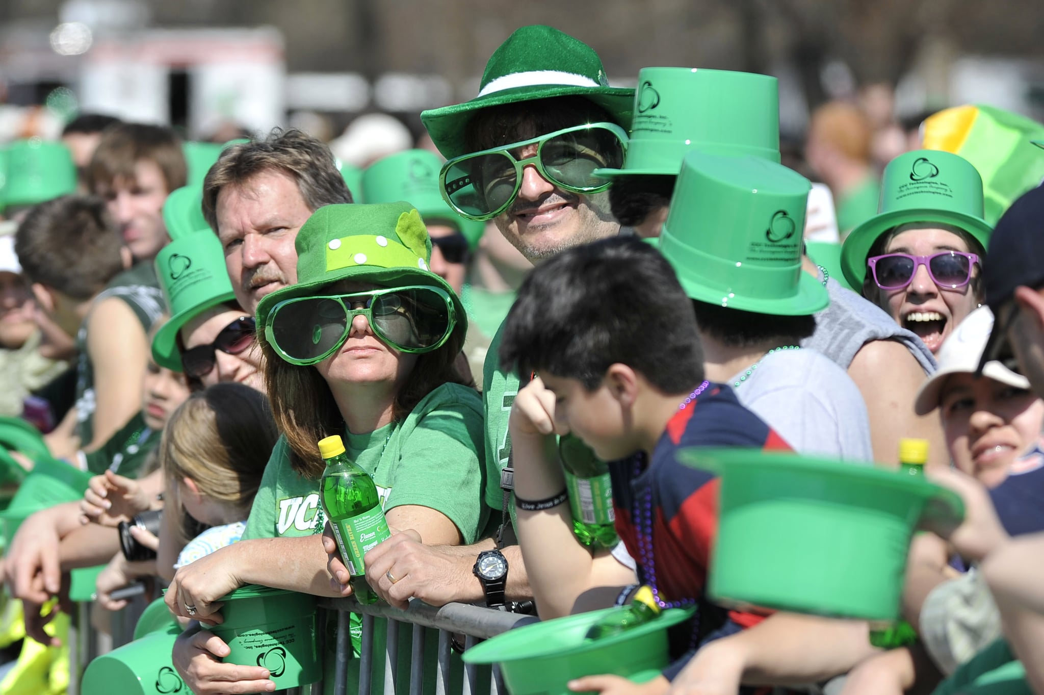Chicagoans sport big green glasses and big green hats.