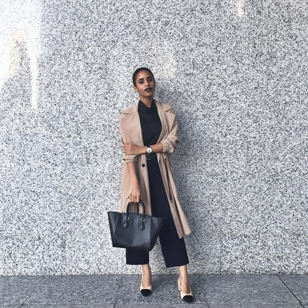 A Black Top, Black Culottes, Cap-Toe Flats, and a Trench