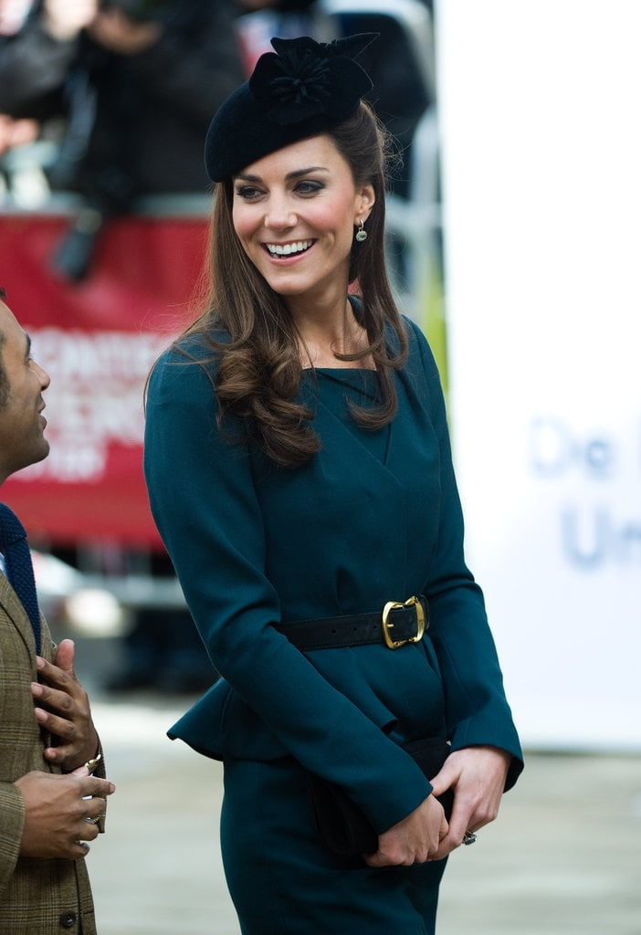 We love that she added a gold buckle belt to her LK Bennett teal peplum skirt suit.