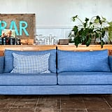 Pictured:  Karlstad three seater sofa cover in strand laundered linen chambray blue Cushion cover in vreta gingham blue/white