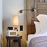 The rooms are full of cute touches including vintage-style radios and lots of lamps which are very necessary seeing as my high-ceiling rooms have no central lighting except for in the hallway. The wardrobes are stocked with flip flops, a hot water bottle, safe, and most importantly, an iron!