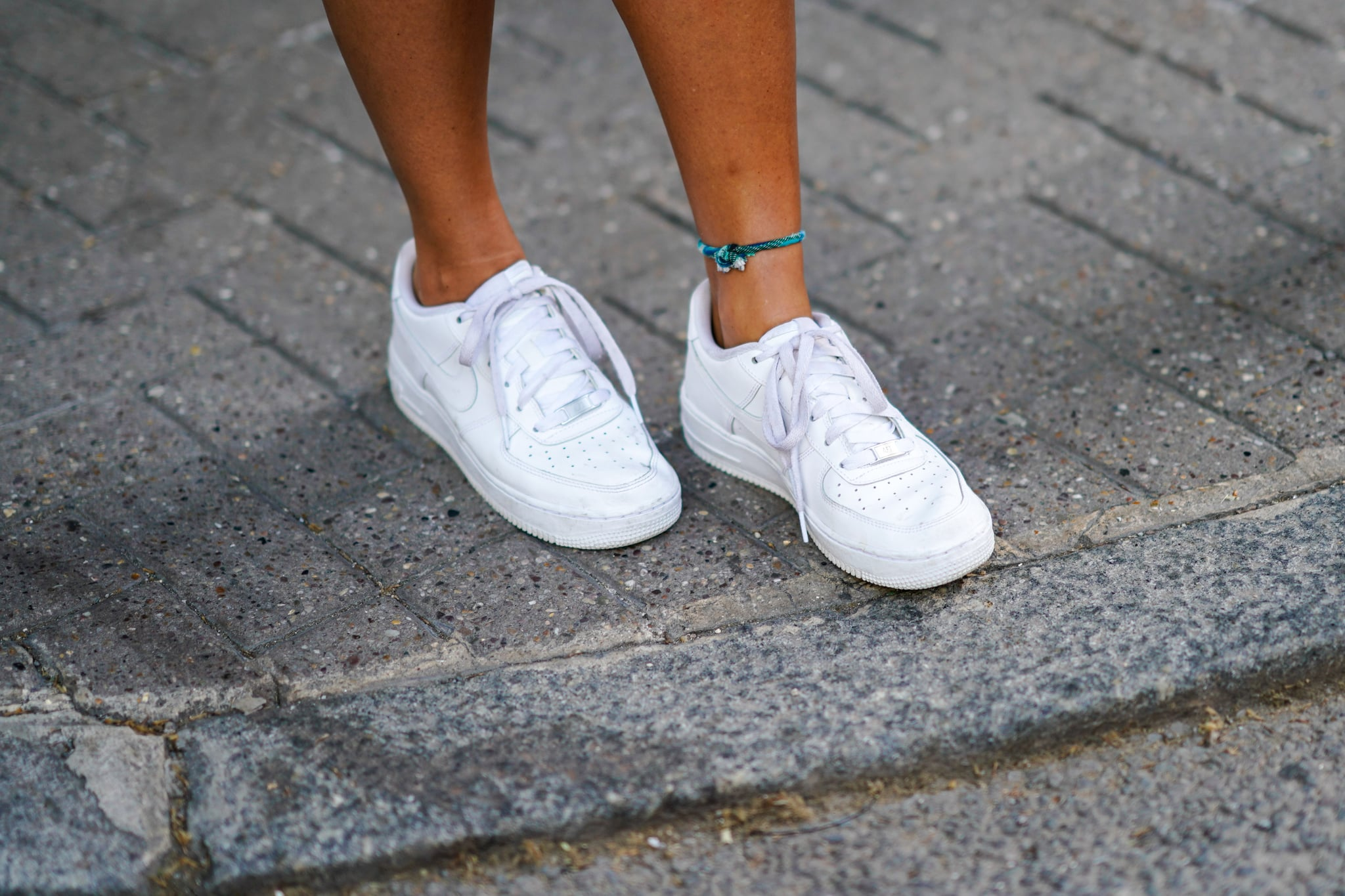 White sneakers are seen, during London Fashion Week Men's June 2018  on June 09, 2018 in London, England.
