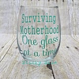 Surviving Motherhood Wine Glass