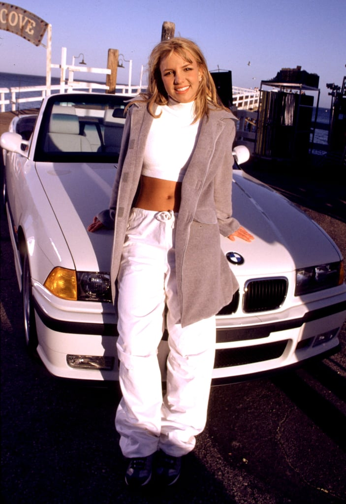 At Malibu wearing a white turtleneck crop top and baggy pants.