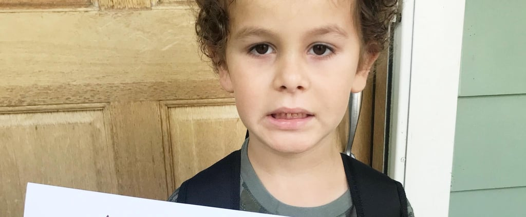 Boy Holding Lazy Version of First-Day-of-School Sign
