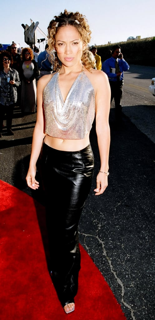 Showing off her toned abs in a draped, metallic halter at the '98 MTV Movie Awards.