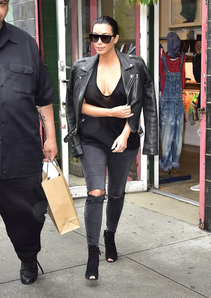 """Kim Kardashian was on the move on Monday. Mere hours after Kim shared her pregnancy news in Sunday's episode of Keeping Up With the Kardashians, the reality star and husband Kanye West braved the rain while leaving their apartment building in NYC. Kim covered up for their exit, wearing ripped jeans and a leather jacket over her low-cut black t-shirt. Although she has yet to discuss the pregnancy on social media, she already shared her excitement about giving North West a sibling in an interview with Glamour. Meanwhile, her mom, Kris Jenner, took to Twitter with her reaction, writing, """"Can't wait to meet your new little love bug!!!!!"""""""