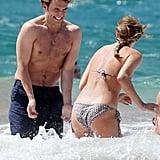 In April 2014, Sam Claflin splashed around with his wife, Lauren Haddock, in Hawaii.