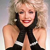 In the Late '80s, Dolly Parton Wore Her Hair Teased and Lips in a Brick Red Hue