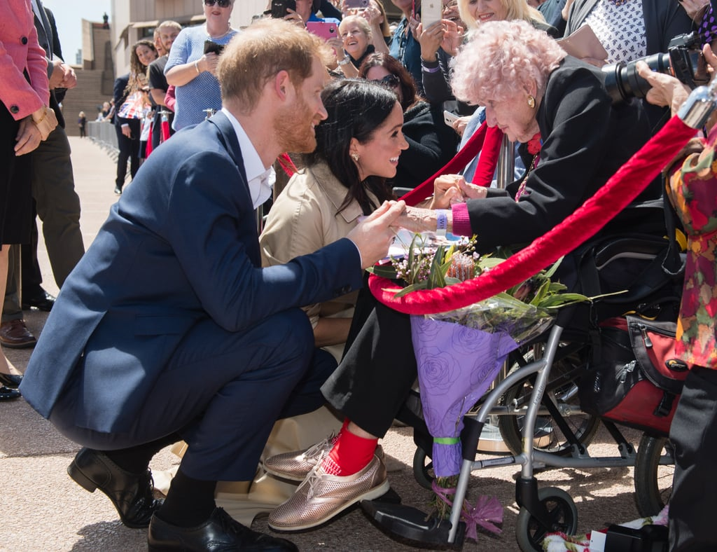 """On April 2, the family of Prince Harry's """"Australian grandma"""" Daphne Dunne shared the sad news that she has died. The Sydney resident died just a few days after her 99th birthday, for which she received a card from the Duke and Duchess of Sussex. Part of their sweet letter read, """"We hope you have a wonderful celebration surrounded by family and friends and that you've managed to escape hospital.""""  Harry first met Daphne in 2015, during a military trip to Australia. They met again two years later, then most recently in October during Harry and Meghan's royal tour of Australia, New Zealand, Tonga, and Fiji. This time, Harry made sure to introduce his wife to his oldest fan. Meghan told Daphne """"hopefully next time we see you, we'll have a little one with us,"""" as prior to the trip, Kensington Palace had announced her pregnancy. Sadly, Daphne won't get to meet baby Sussex, but she did at least get one final message from her beloved royals before she died. As her family shared the news, they did so with a poignant message: """"It is fitting that Daphne passed away on the first of April as it is a month of renewal, remembrance and reunification with her loved ones that passed before her."""" Ahead, get a closer look at all of Daphne's sweet interactions with Harry and the moment she met Meghan, who she claimed was """"just what the prince needs.""""      Related:                                                                                                           Prince Harry and Meghan Markle Are So Kind to Elderly Women and, Yes, We Noticed"""