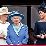 Camilla and Meghan chatted alongside Queen Elizabeth on the Buckingham Palace balcony during the July centenary parade, marking the 100th birthday of the Royal Air Force.