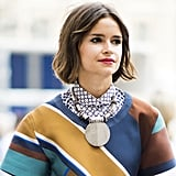 Miroslava Duma emboldened an already eye-catching top with an oversize pendant. Source: Adam Katz Sinding