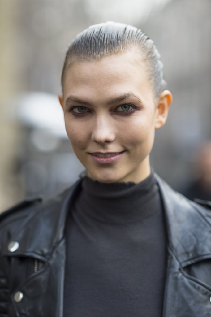 Karlie Kloss showed face between shows with a slicked-back style and purple shadow. Source: Le 21ème | Adam Katz Sinding