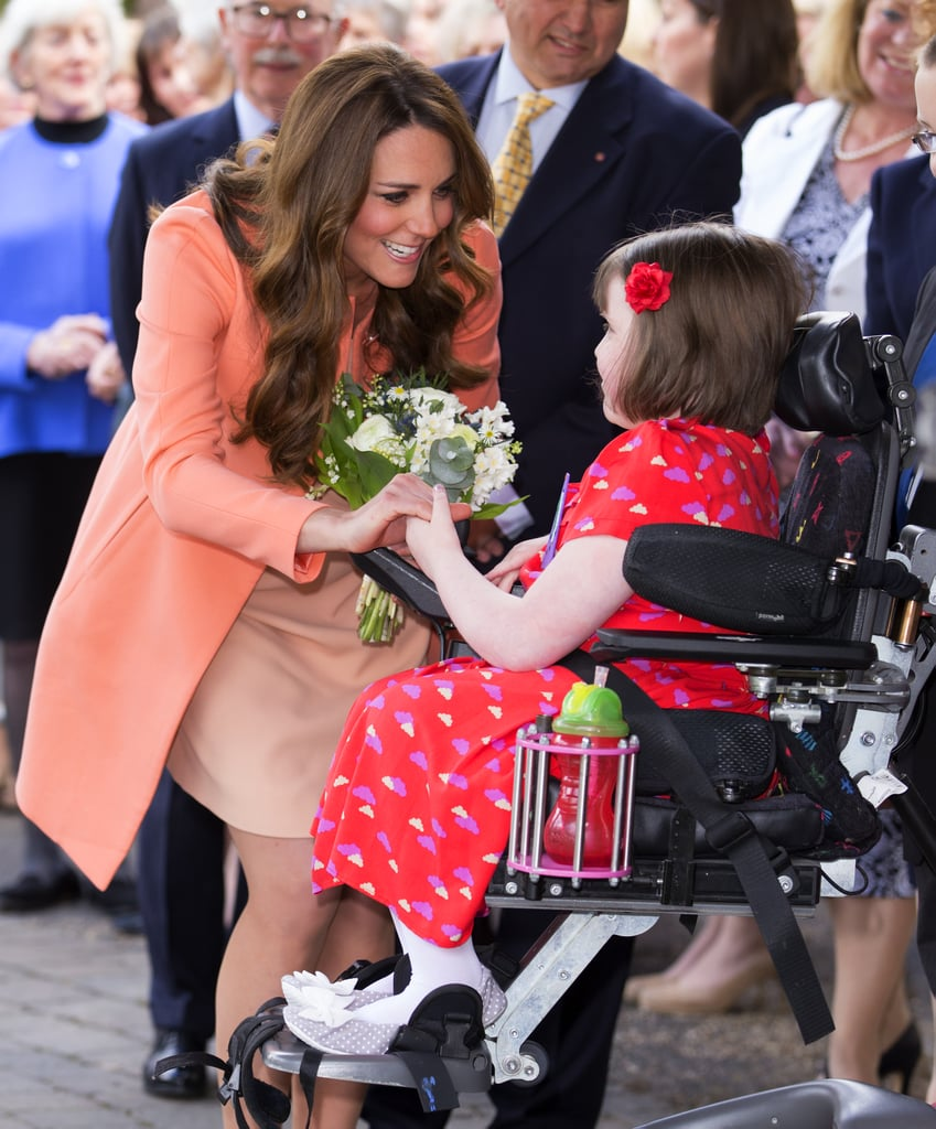 She chatted and smiled with a little girl named Sally Evans during her visit to the Naomi House Children's Hospice in April 2016.
