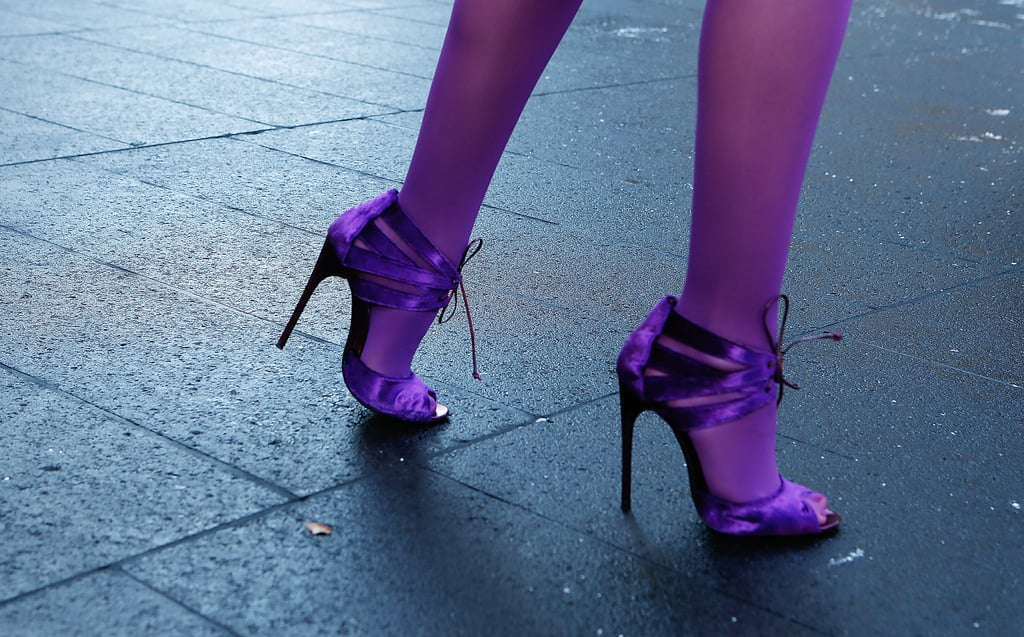 Metallic purple lace-ups were a perfect match against her violet-hued tights.