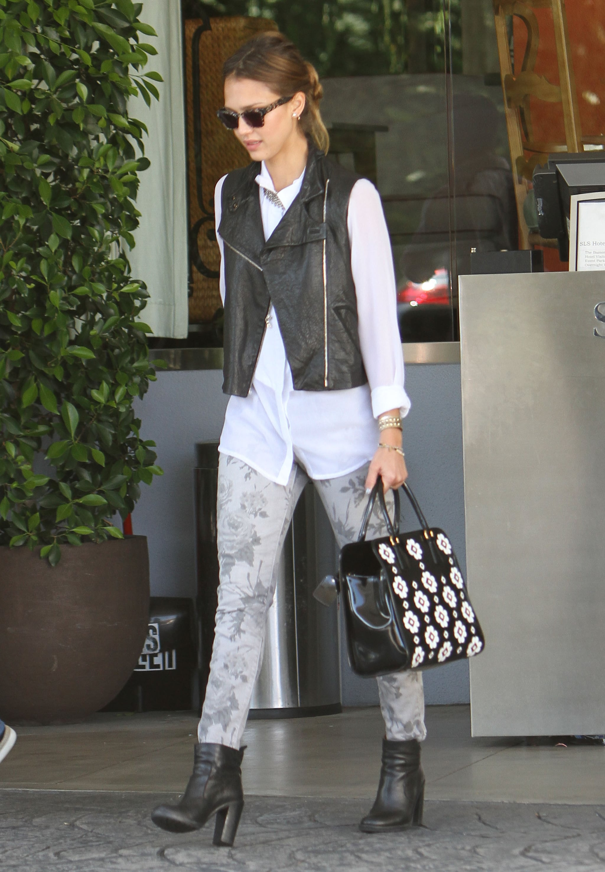 Jessica doubled up on florals, styling printed Current/Elliott jeans with an appliqué Prada tote and adding a biker-chic touch via a black leather Two by Vince Camuto vest and matching ankle boots at the SLS Hotel in West Hollywood.