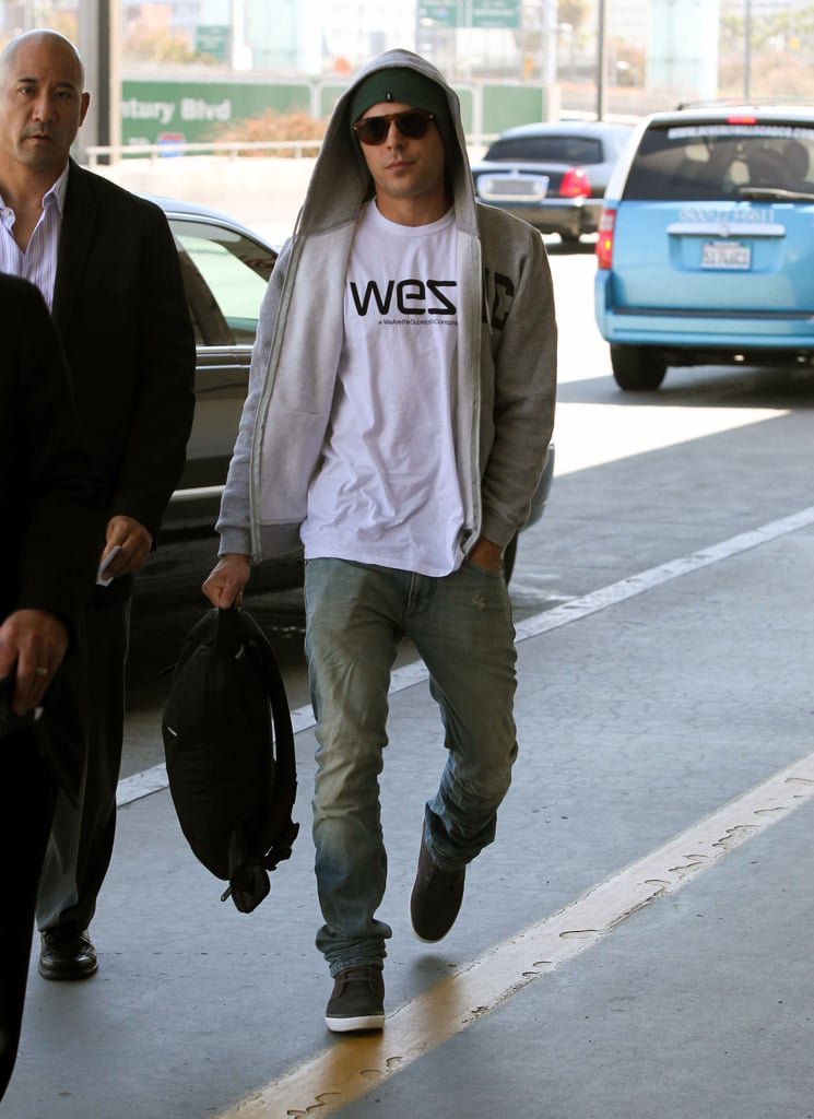 Zac Efron wore jeans and dark sneakers.