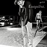 Ashton Kutcher rested his hand on his head while shooting by a pool for Esquire.