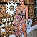 Taylor Hill wearing a belted floral slit dress at the Winter Bumbleland party.