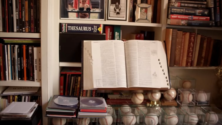 Matthew Broderick is a known baseball fan, and it appears that he's a collector of baseballs, too. If you look just beyond them, we even get a sneak peek at what appear to be family photos tucked away on the bookshelves.
