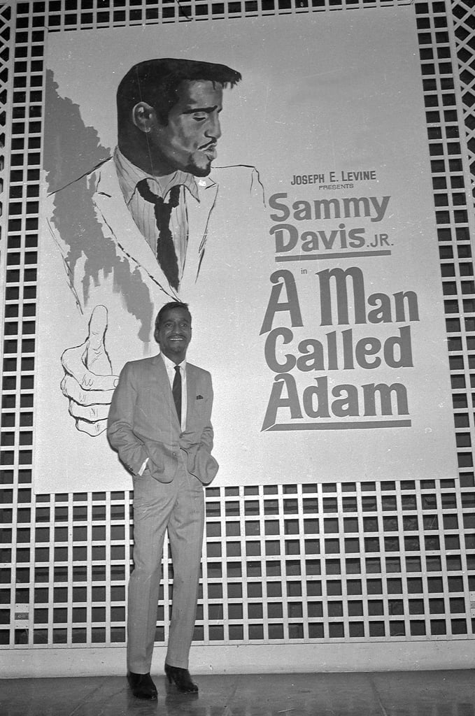 Sammy Davis Jr. took photos in front of the poster for his film A Man Called Adam in 1966.