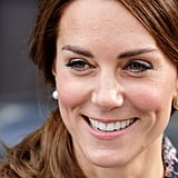 For a trip to Manchester, Kate chose $190 pearl and gold studs by Oscar de la Renta.