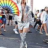 A guest wearing a metallic jacket and matching thigh-high boots with silver gym shorts.