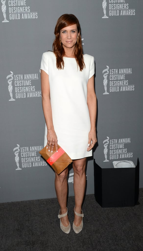 Kristen Wiig went minimalistic in a little white dress, grey ankle-strap Christian Louboutin pumps, and a two-tone clutch.