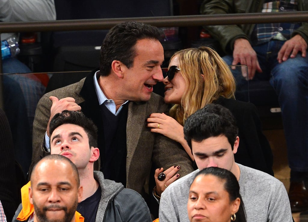 Mary-Kate Olsen and boyfriend Olivier Sarkozy squeezed in PDA when they watched the New York Knicks play the Miami Heat in NYC last night. The couple sat in the stands together and chatted, snuggled, and kissed, despite their team losing 99-93.  Mary-Kate skipped out on recent stylish fun during Paris Fashion Week, where her sister Ashley Olsen and stars like Jessica Alba, Marion Cotillard, and Jessica Chastain attended various shows. However, Mary-Kate, who recently released a new handbag collection for Elizabeth and James with sister Ashley, may have a chance to catch a show in the City of Light before Fashion Week ends on March 6.