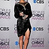Jennifer Lawrence donned a Valentino Couture dress to kick off her big award season at the People's Choice Awards in LA, where she earned her first win: favorite movie actress for her work in The Hunger Games.