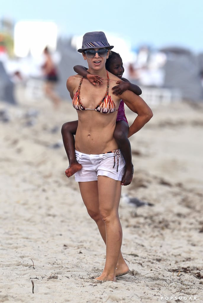 Jillian Michaels carried her daughter, Lukensia, along the beach in Miami.