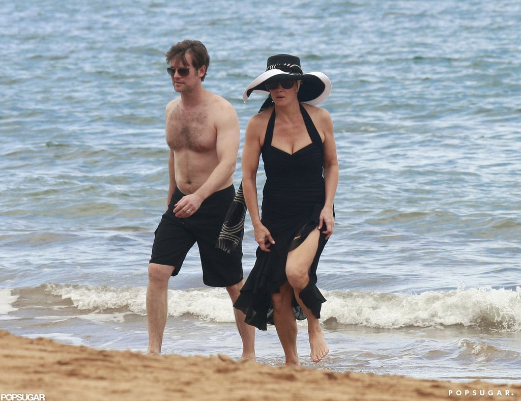Peter Krause hit the beach shirtless to film with his costar Monica Potter.